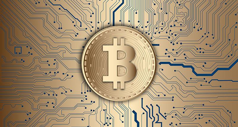 Bitcoinsymbolen på en guldig bakgrund.